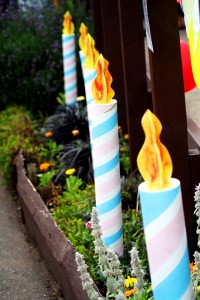 giant candles standing in garden