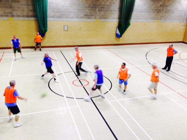 A group of men play a game of walking football.
